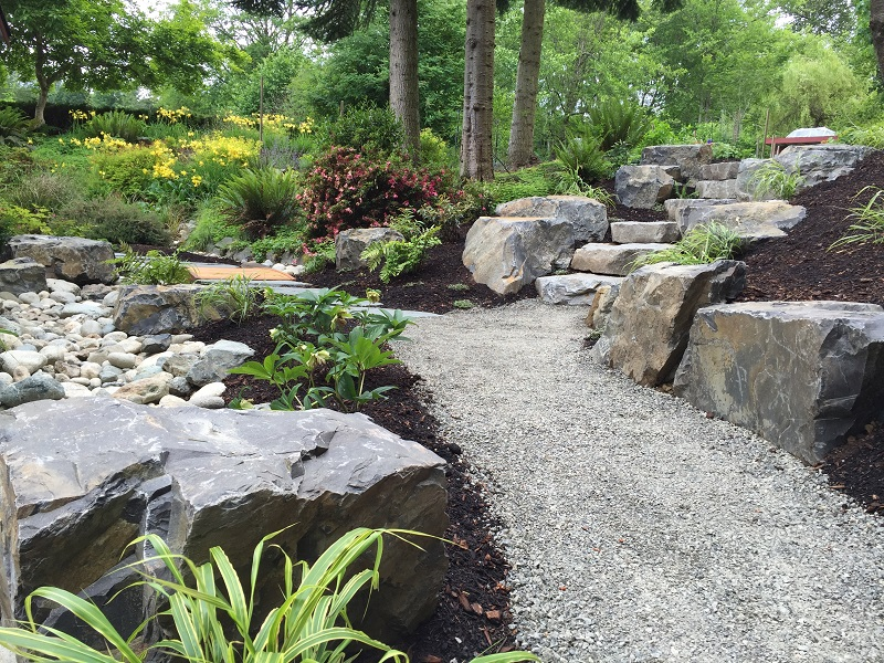Snohomish Huckleberry Stone Risers with Brown Basalt Boulders by Sublime Garden Design (800x600)